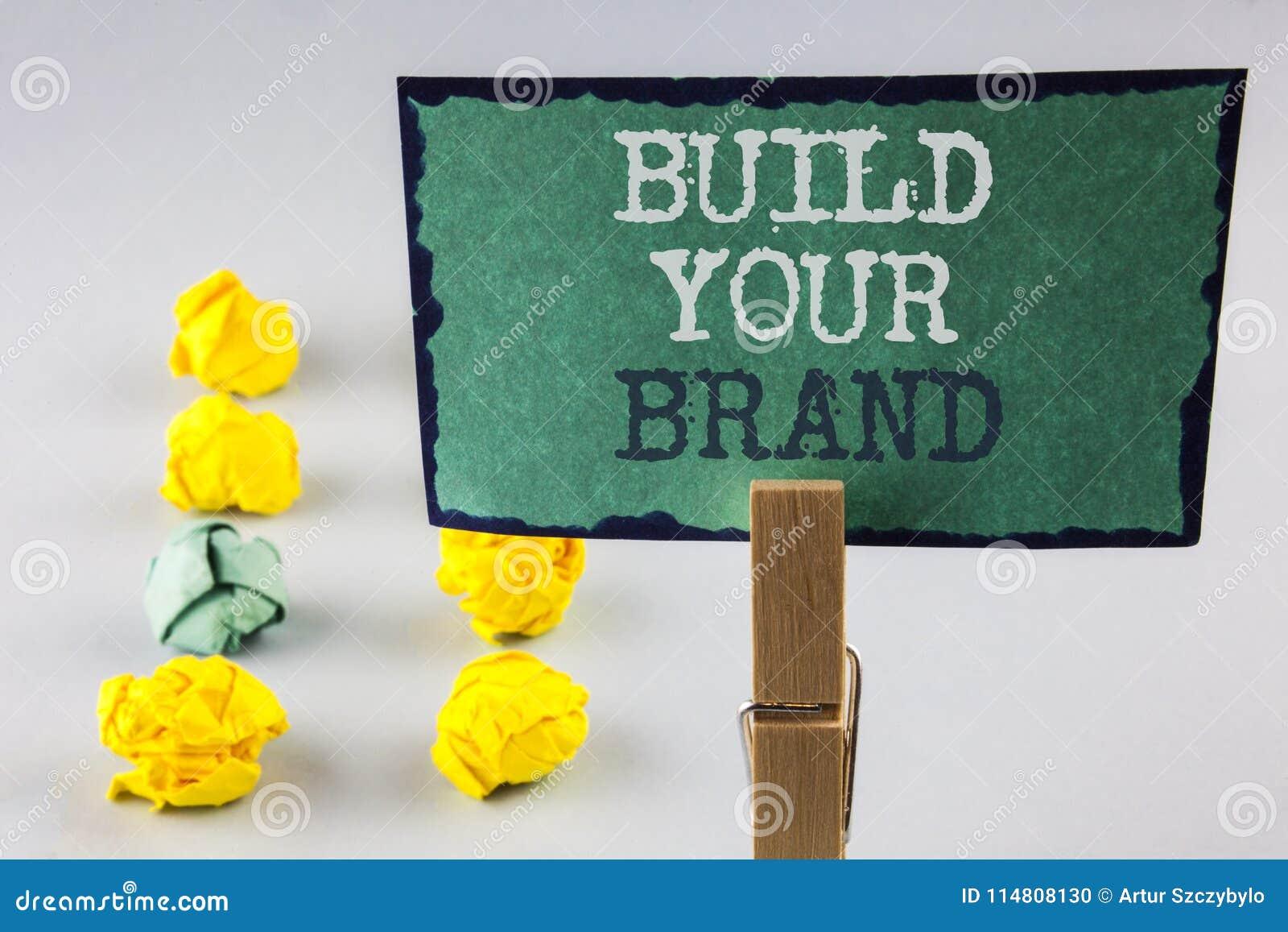 Byggande för handskrifttexthandstil ditt märke Begreppsbetydelsen skapar din egen logosloganmodell som annonserar att marknadsför