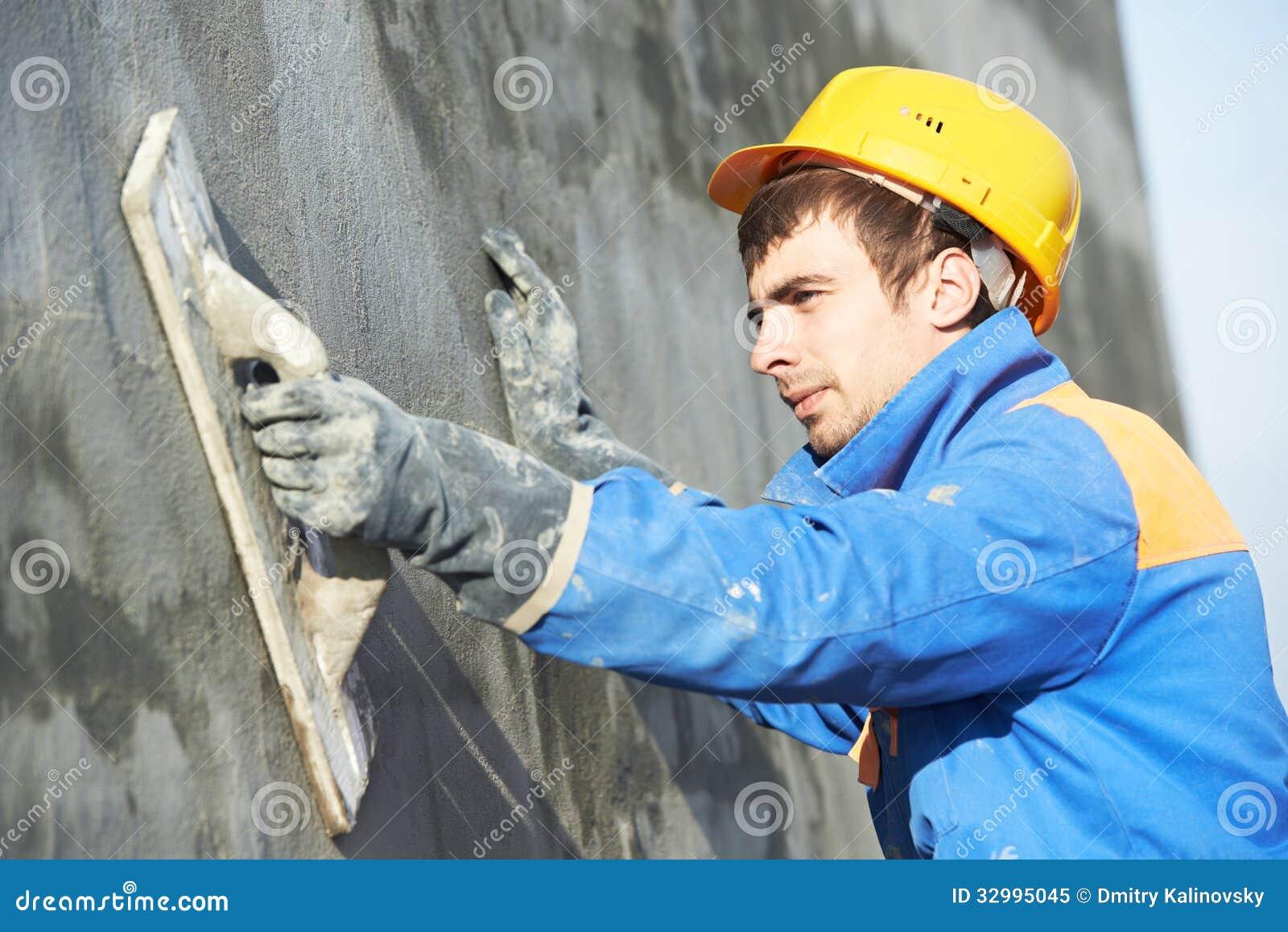 Byggmästarearbetare på att rappa fasadarbete
