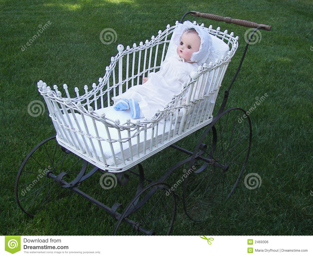 old doll in vintage buggy