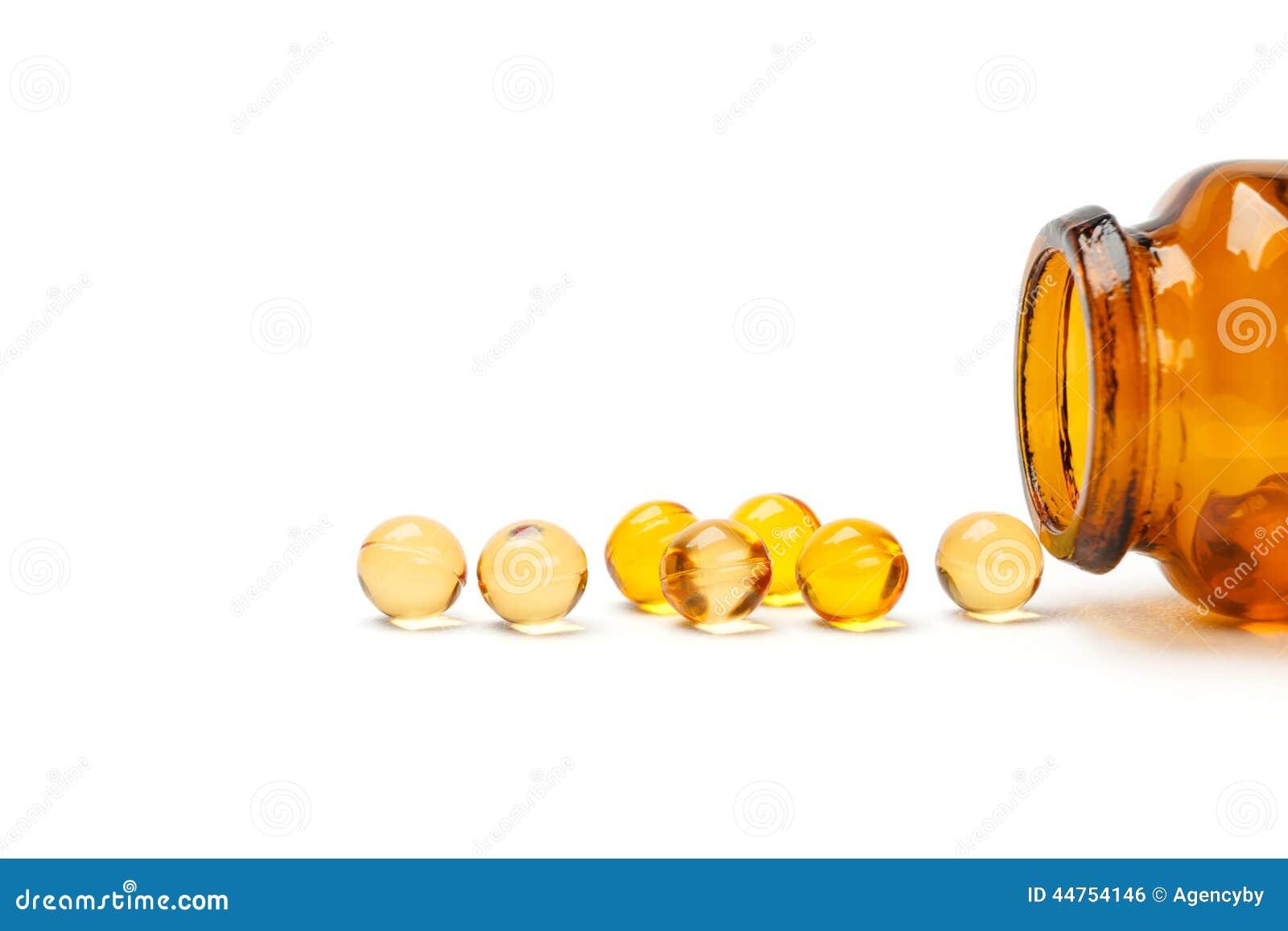 Cápsula da vitamina do óleo com garrafa