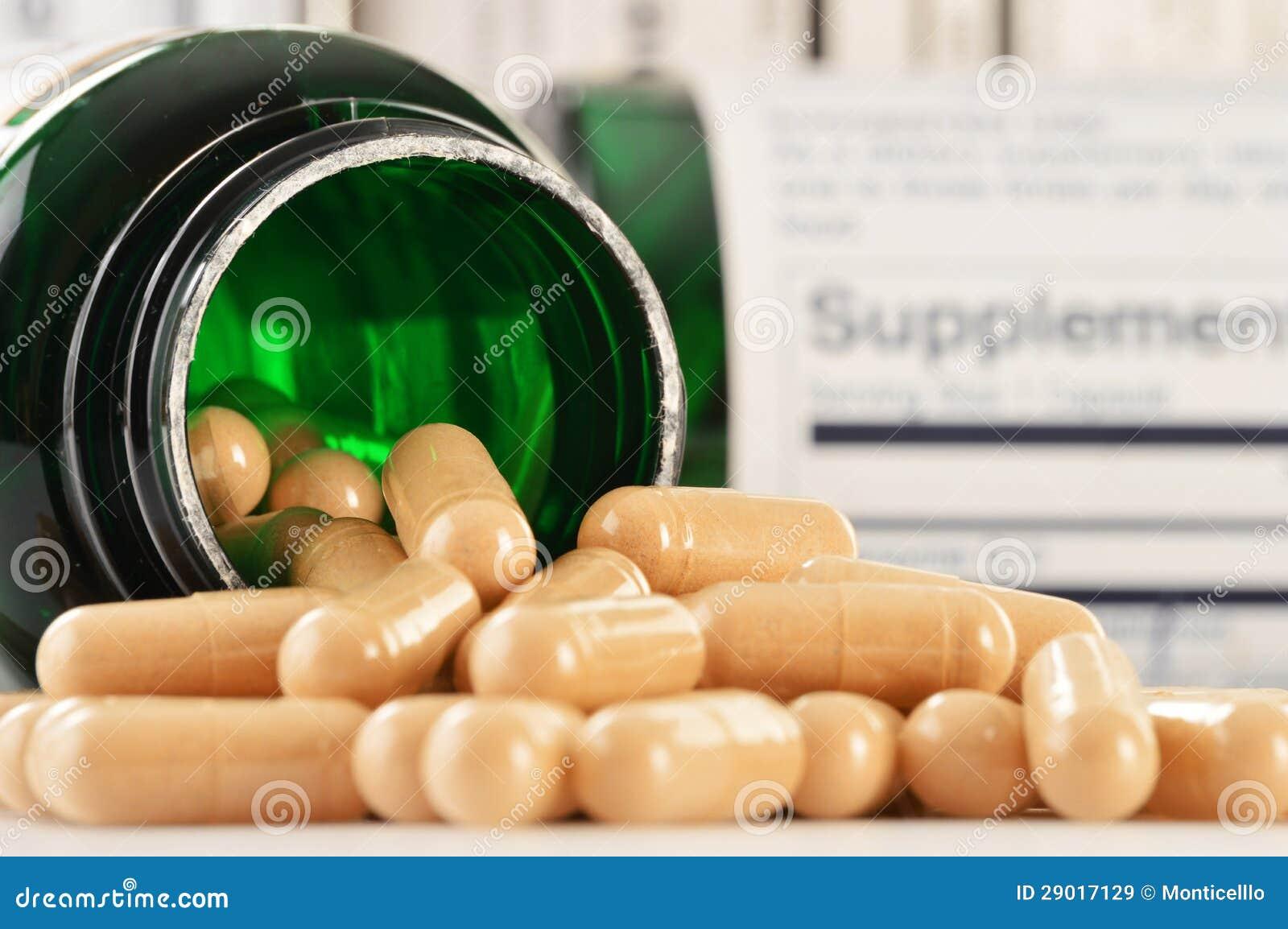 Cápsulas do suplemento dietético. Comprimidos da droga