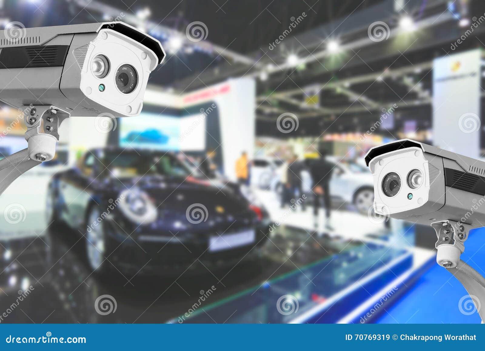 Câmera do CCTV de carros comerciais na sala da mostra