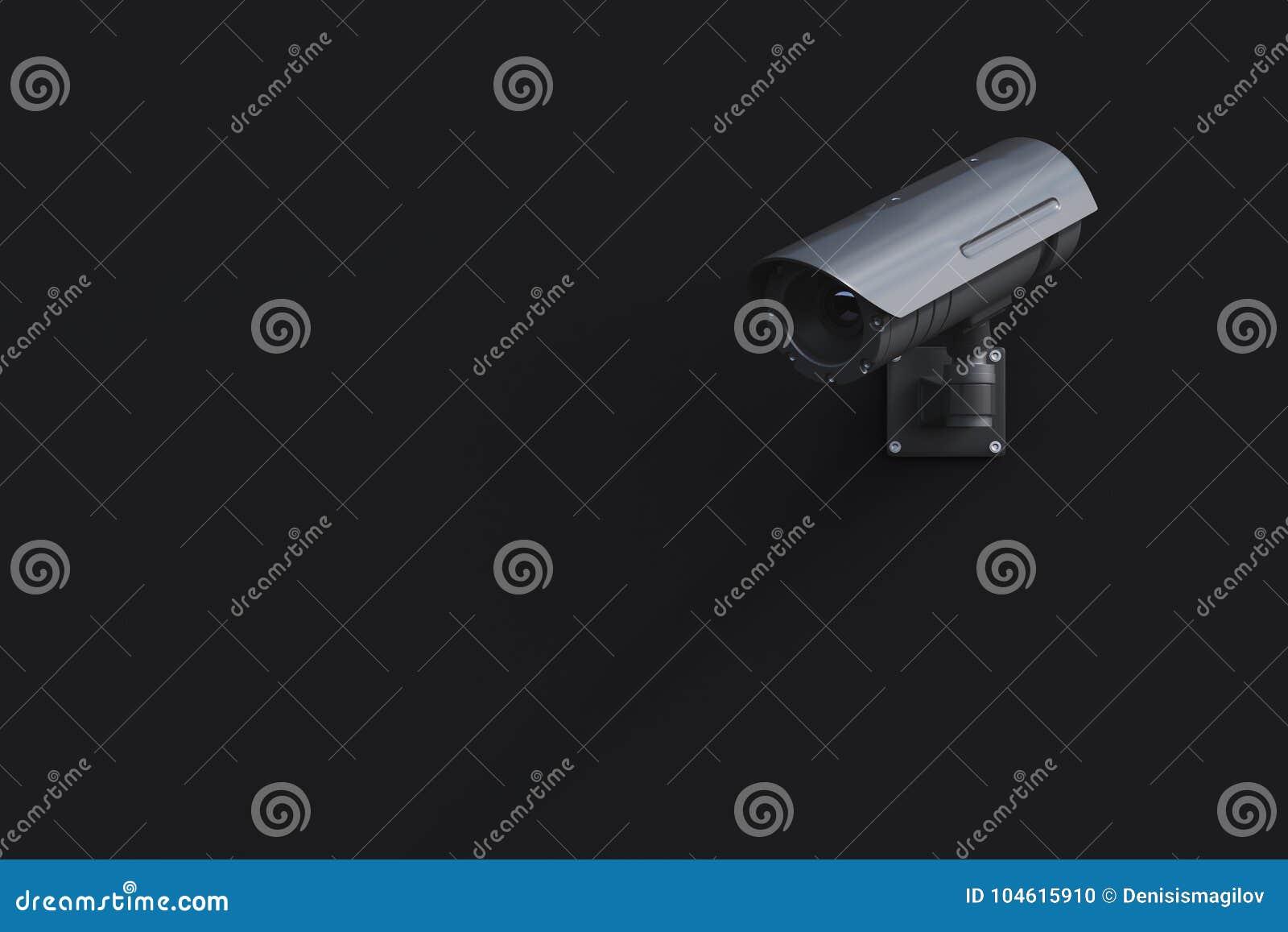 Câmera preta do CCTV em uma parede preta