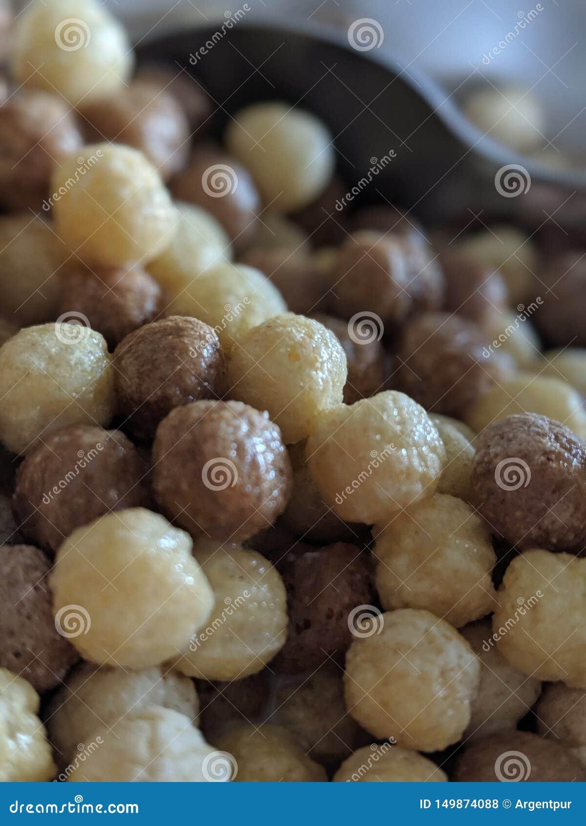 Céréale de matin avec la cuillère à l arrière-plan