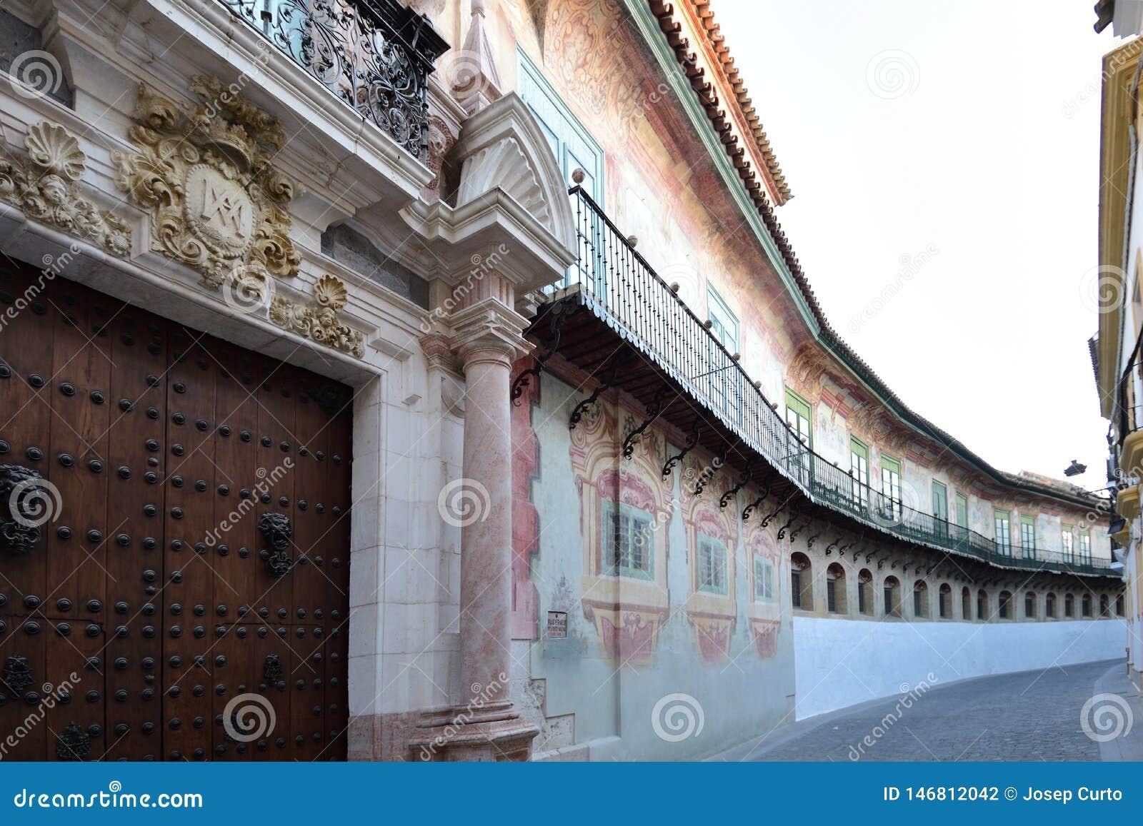 Caballeros ulicy, pałac Peñaflor, Ecija, Sevilla prowincja, Andalusia, Hiszpania