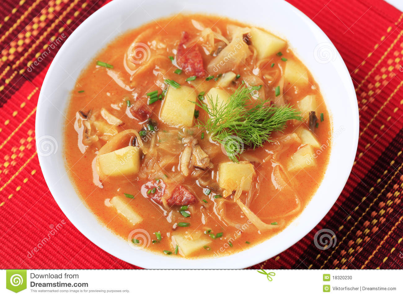 Cabbage soup with potatoes and sausage - detail.