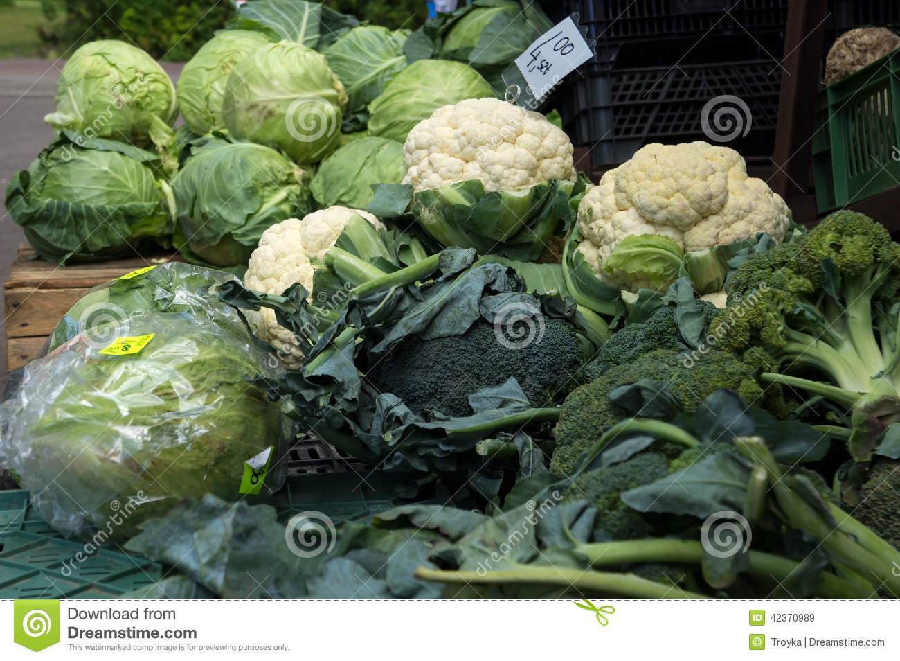 Cabbages, cauliflowers and broccoli at market.