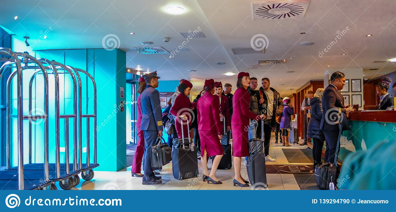 Cabin crew checking into their overnight stop off. Shows crew queing up to check in