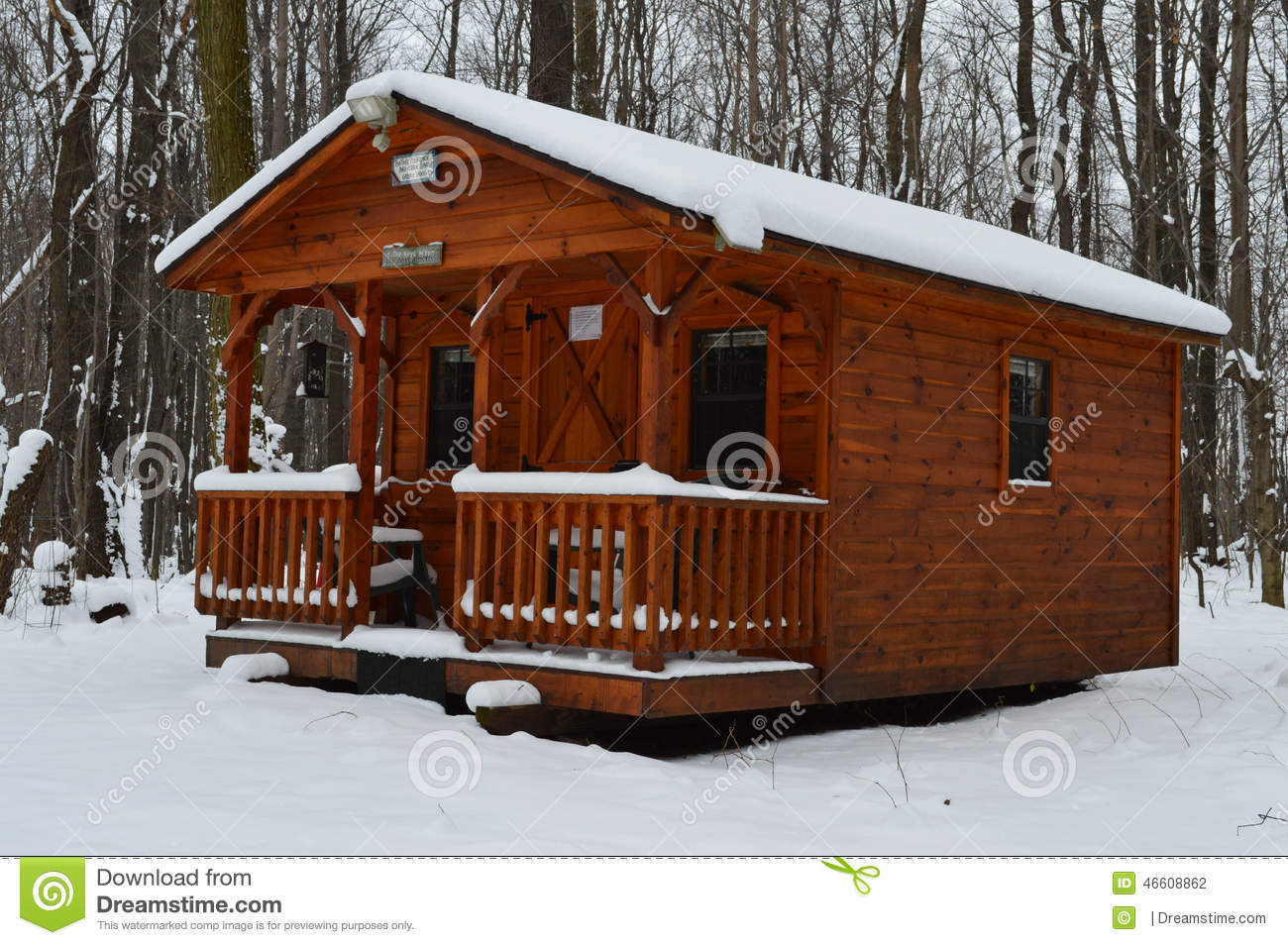 Log cabin in the woods winter - Royalty Free Stock Photo