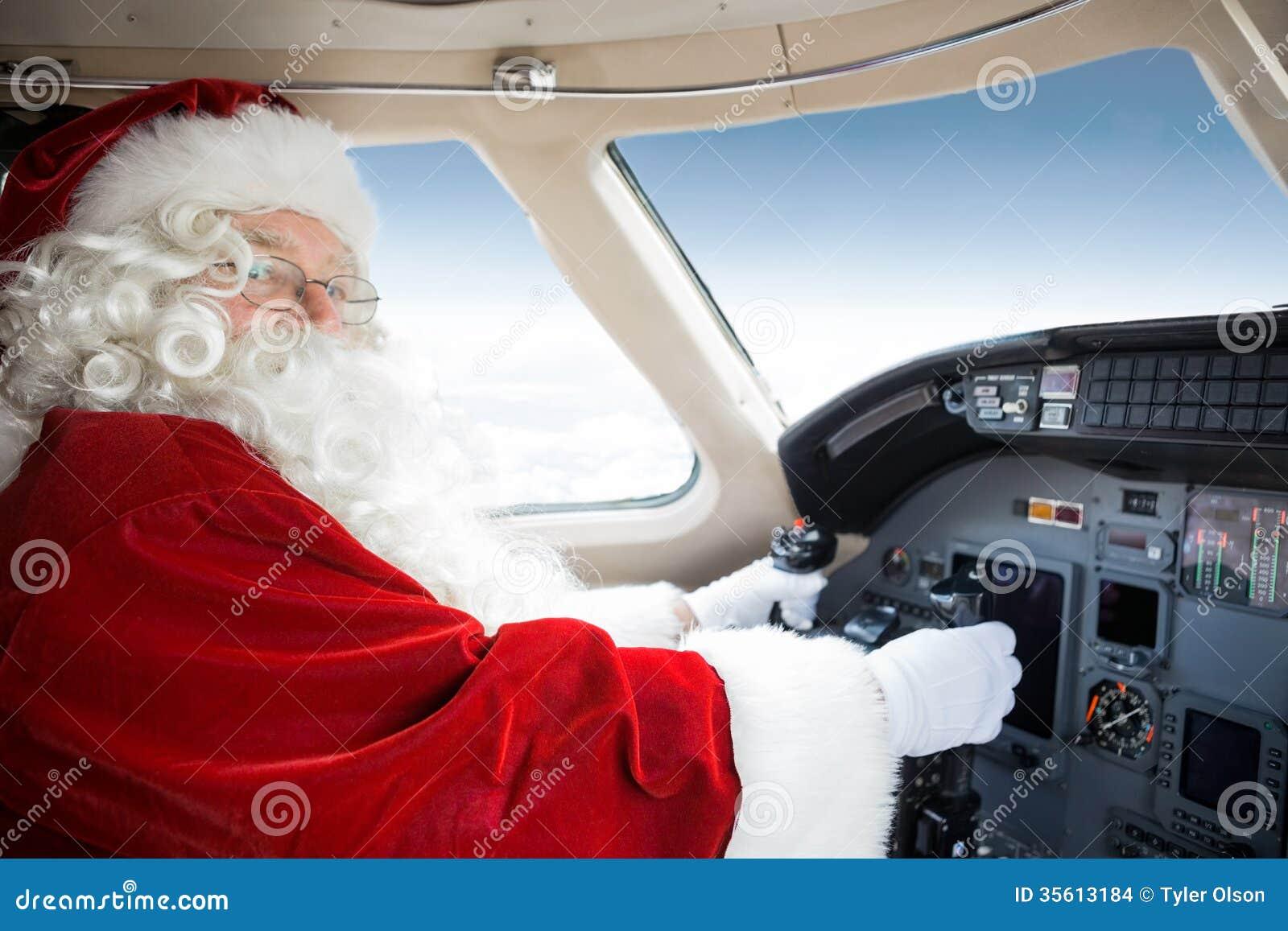 Cabina do piloto de Santa Holding Control Wheel In de privado