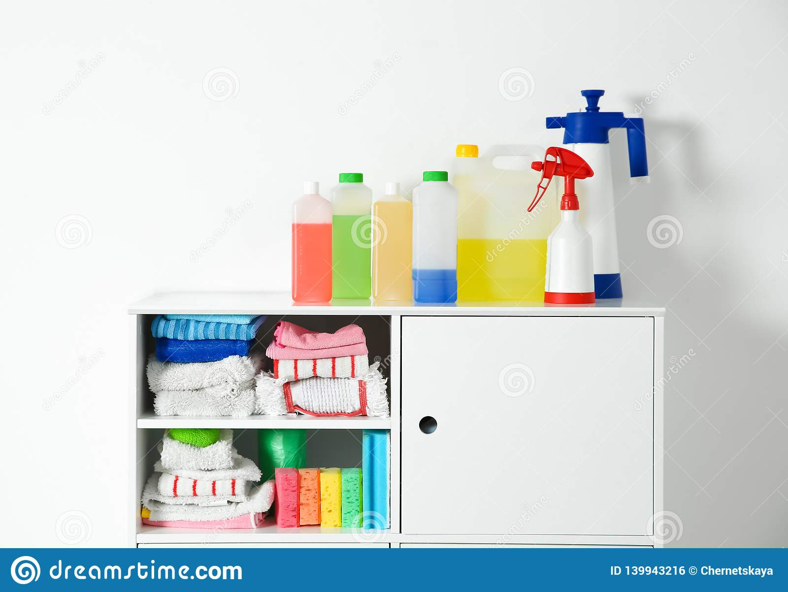Cabinet With Different Cleaning Supplies On White Stock Photo