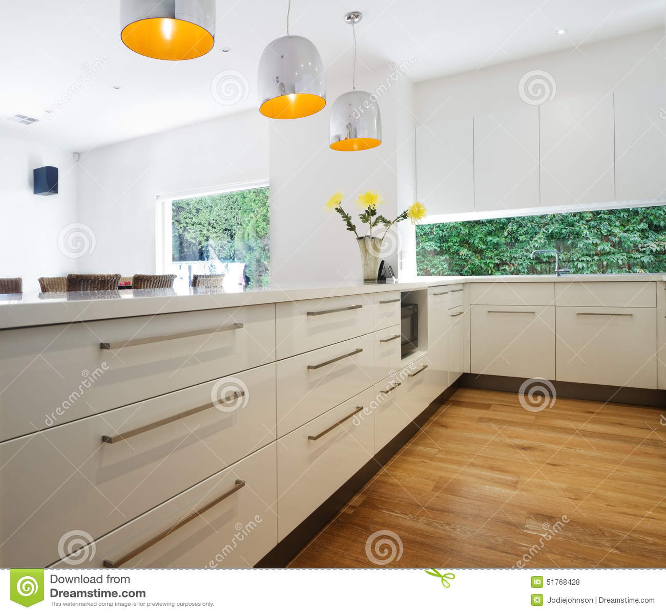 Luxury Home Kitchen Island With Hanging Lights Stock Image