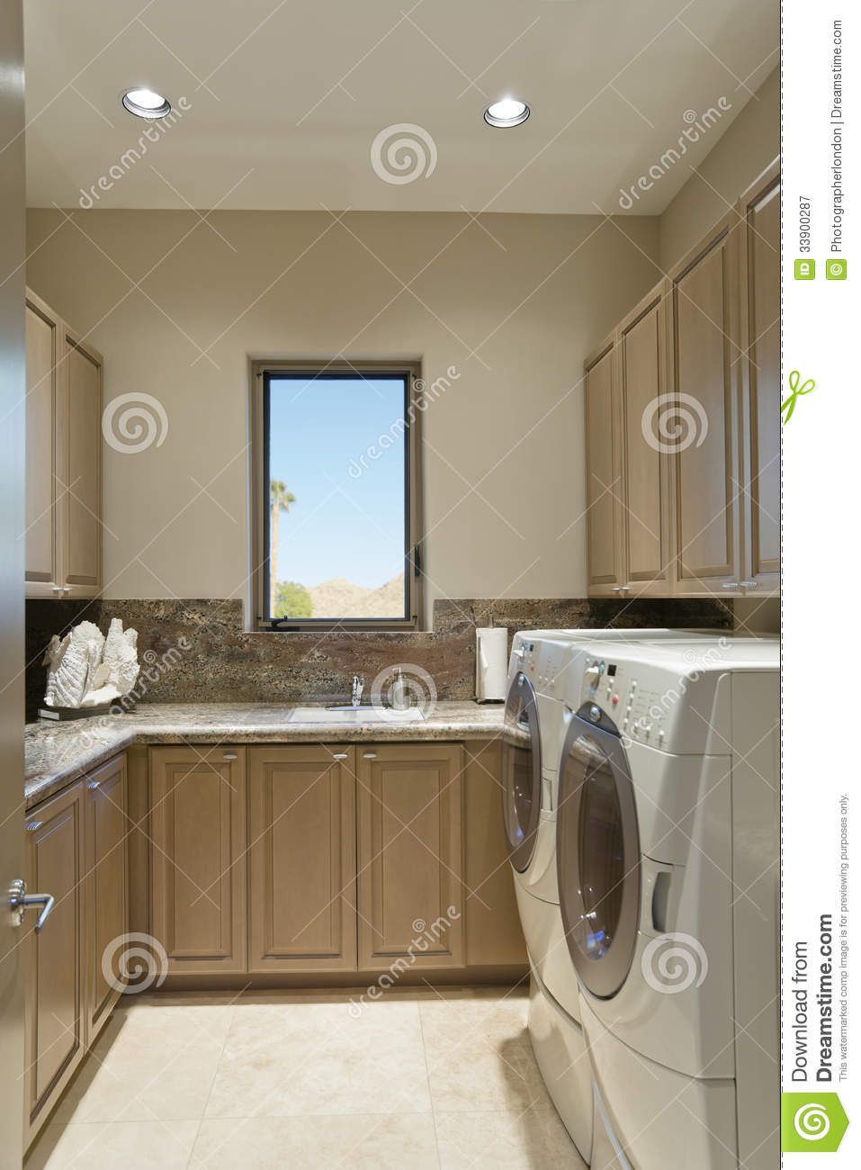 Cabinets And Washing Machine In Laundry Room Stock Image