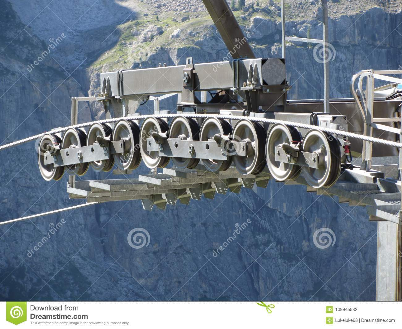 cable car gear wheels with mountains background rollers and