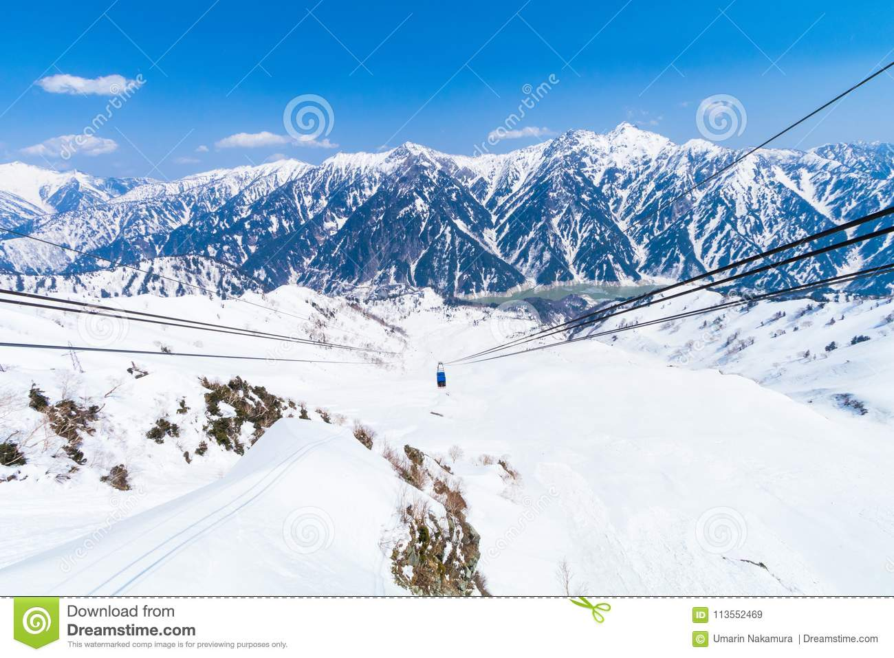 Cable car going to Tateyama Kurobe Alpine Route and the snow mountains wall , Beautiful landscape the view on Tateyama Japanese A