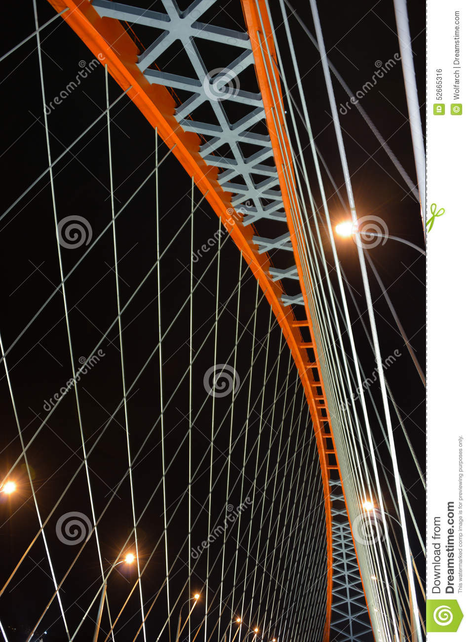 Cable-stayed through arch bridge (Bugrinsky Bridge) over river Ob at night, in Novosibirsk, Siberia, Russia