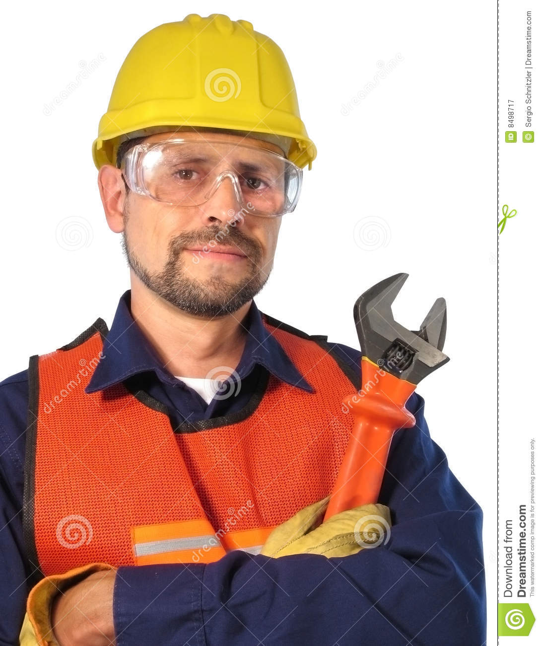 ... , wearing safety, helmet, glasses and gloves, carring a wrench