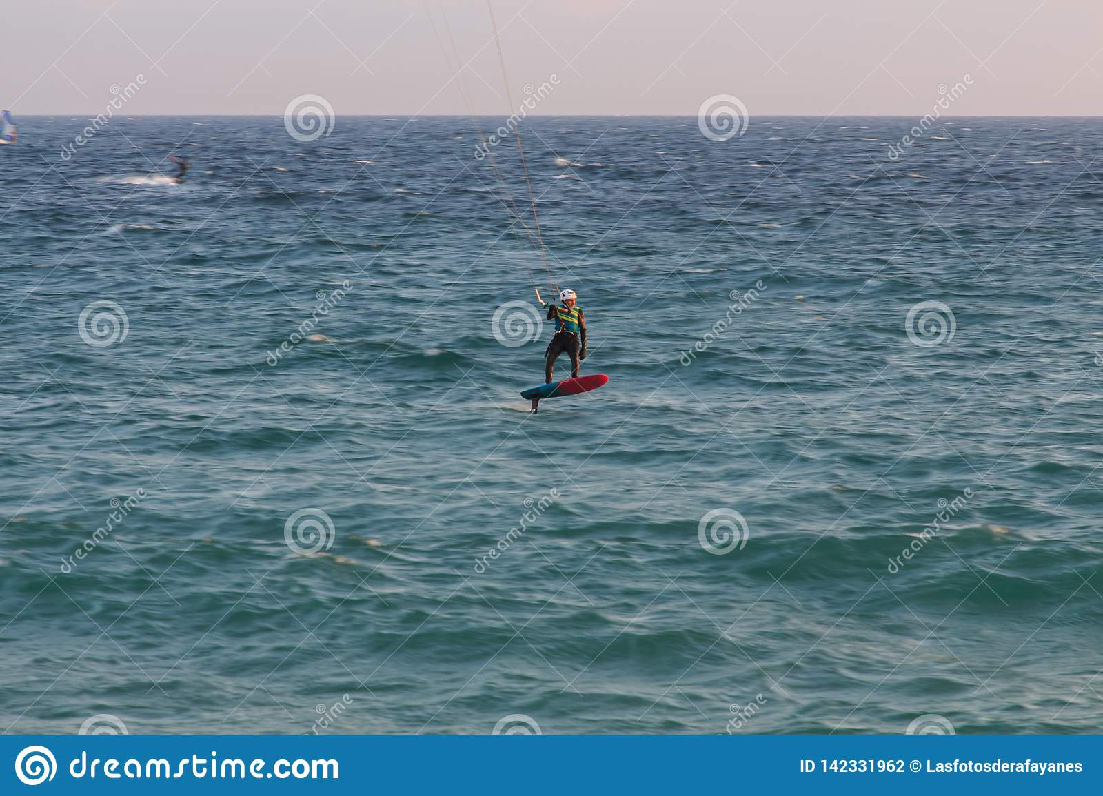Cabrera de Mar,Barcelona/Spain; 02 08 2019: A good afternoon to practice Windsurfing and Kitesurfing Flysurf at Cabrera beach at