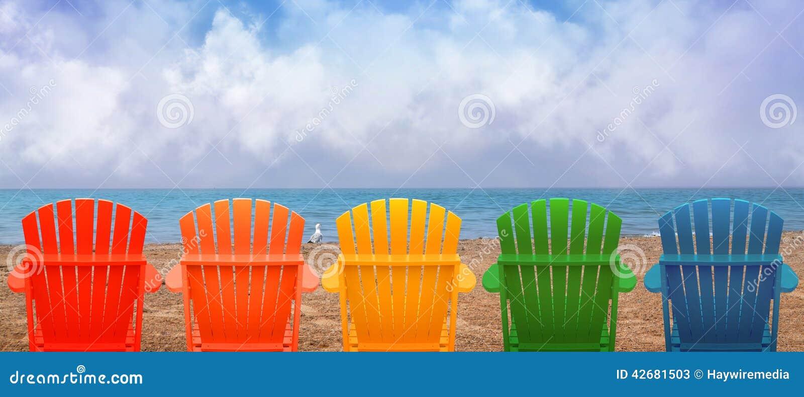 Cadeiras de praia das férias na areia