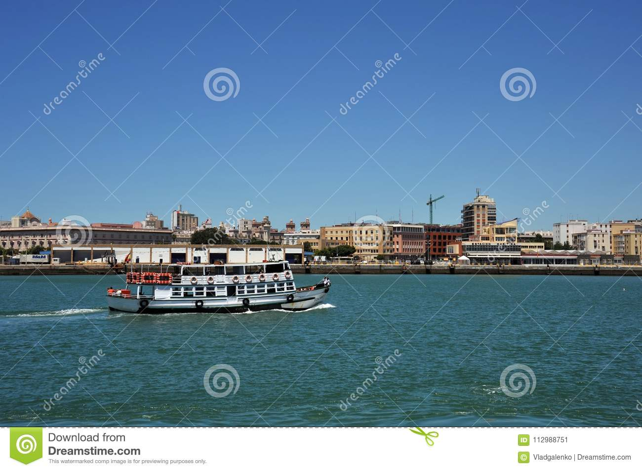 Ships in the harbor of the seaport of Cadiz on the shores of the Cadiz Bay of the Atlantic Ocean.