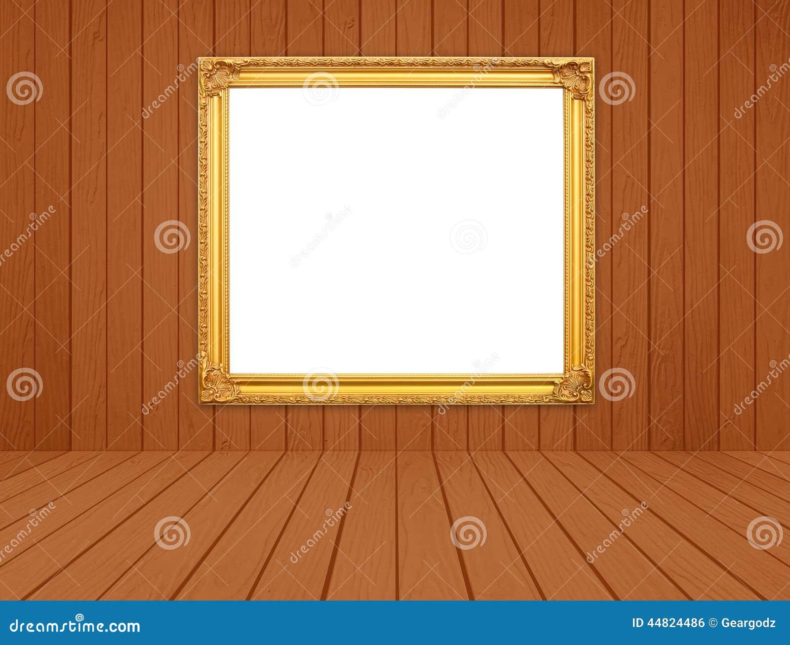 Cadre d'or vide dans la chambre avec le plancher en bois blanc de ...