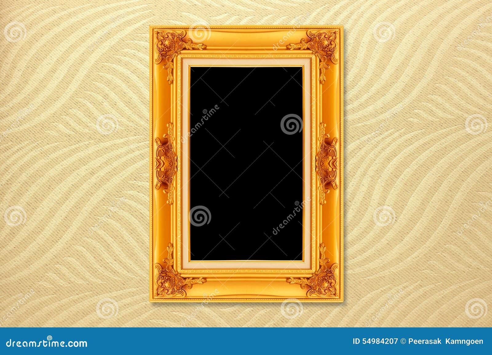Cadre d or vide de vintage sur le papier peint