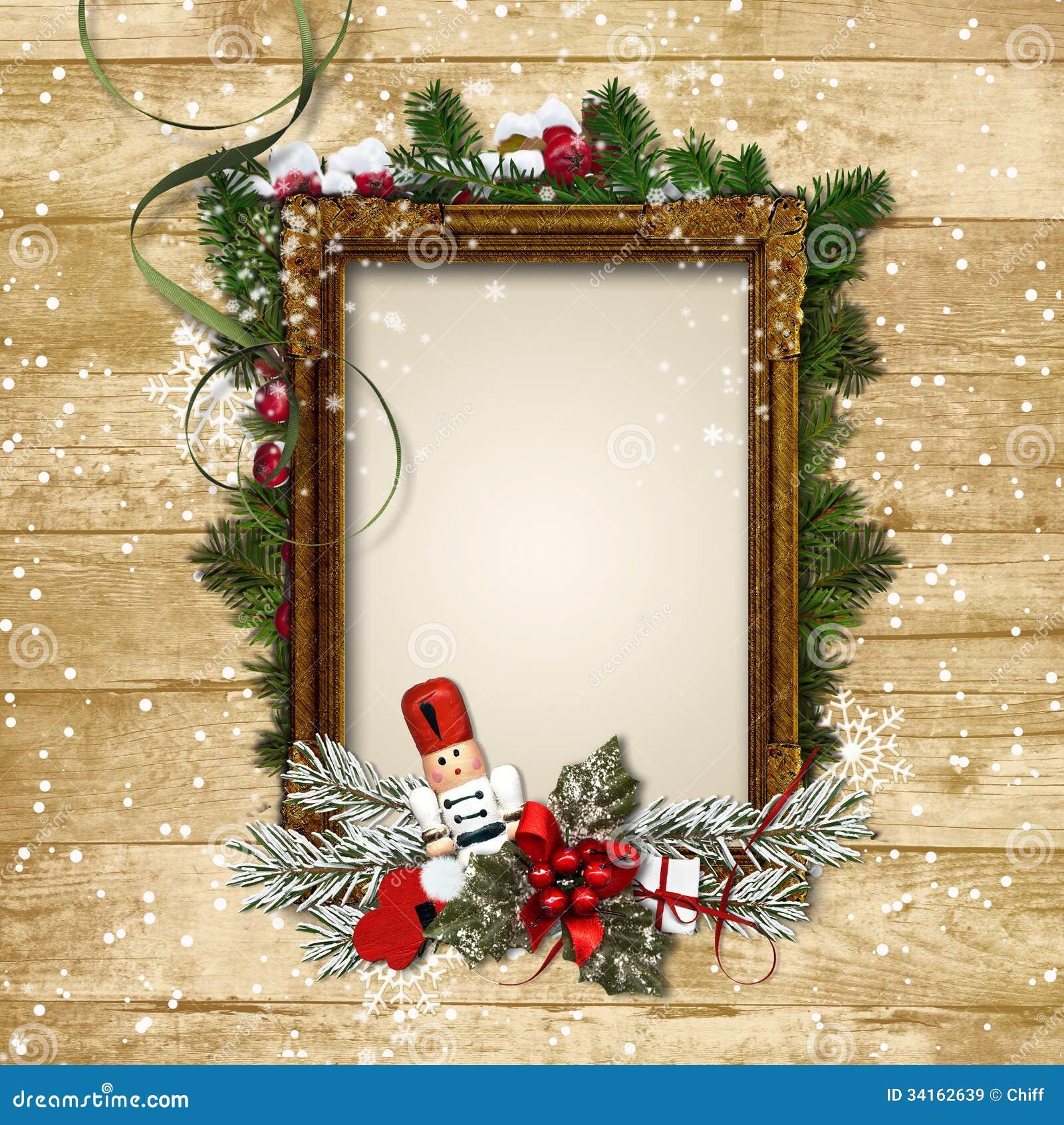 Cadre de Noël avec le décor et le casse-noix sur un Ba en bois