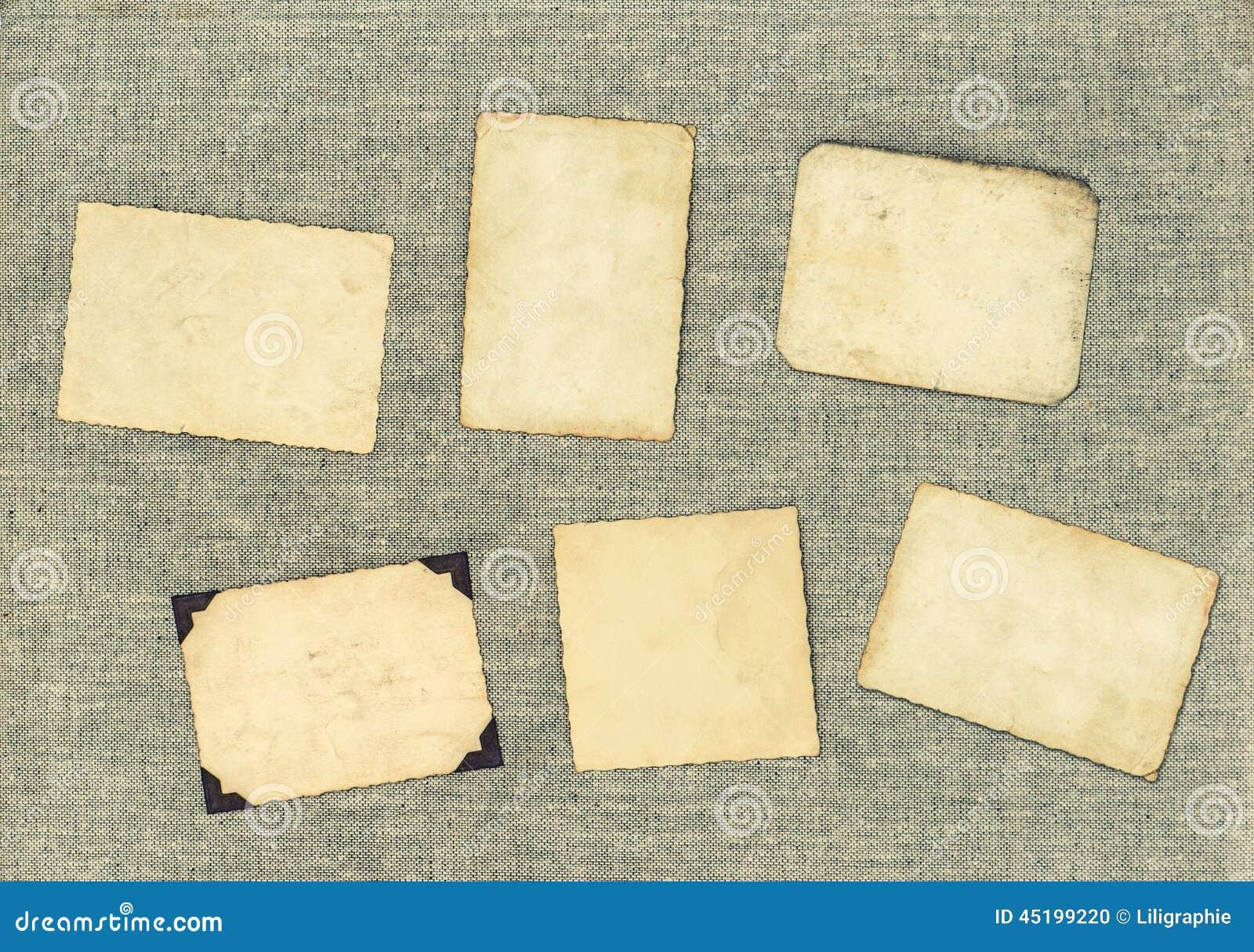 Cadres de photo de vintage au-dessus de fond de textile Papier âgé
