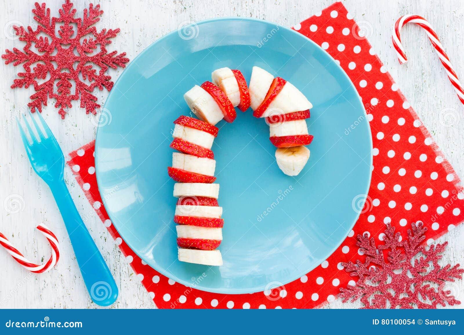 Café da manhã para crianças - morango c do petisco da sobremesa do Natal da banana