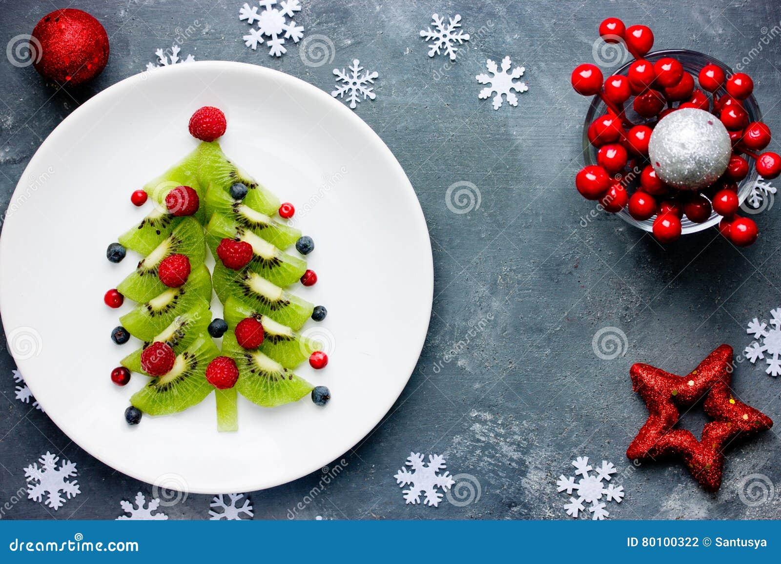 Café da manhã saudável para crianças - bluebe do petisco da sobremesa do Natal do quivi