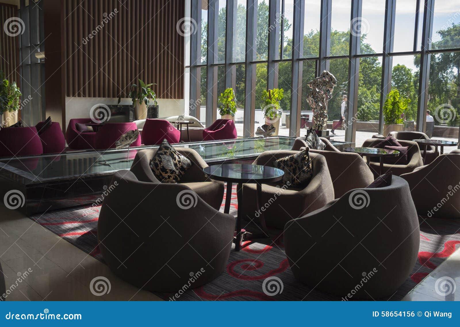 Café en el diseño de ŒInterior del ¼ del lobbyï del hotel