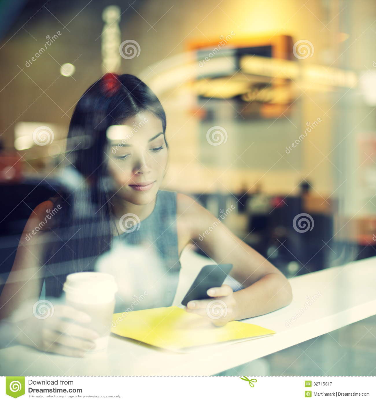 Cafe city lifestyle woman on phone drinking coffee