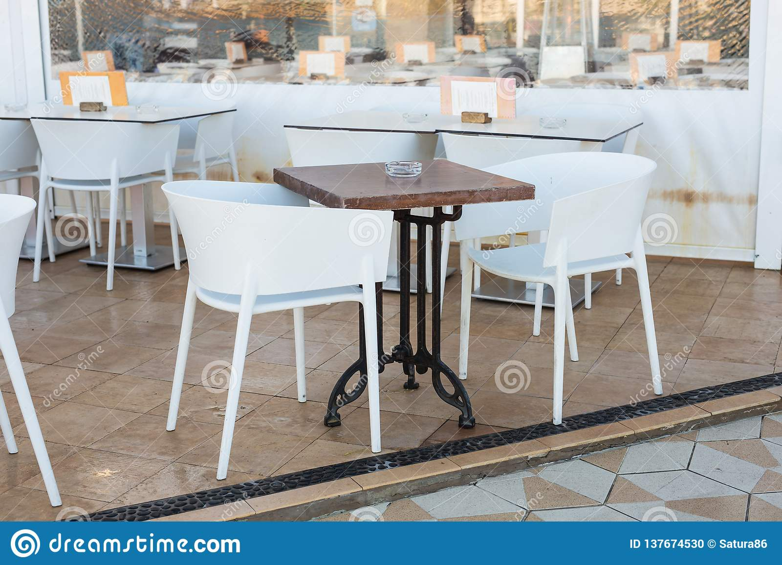 Cafe Coffee Shop Tavern And Restaurant Concept Empty Tables In Between Dining Hours In Europe Town Stock Photo Image Of Arrangement Hotel 137674530