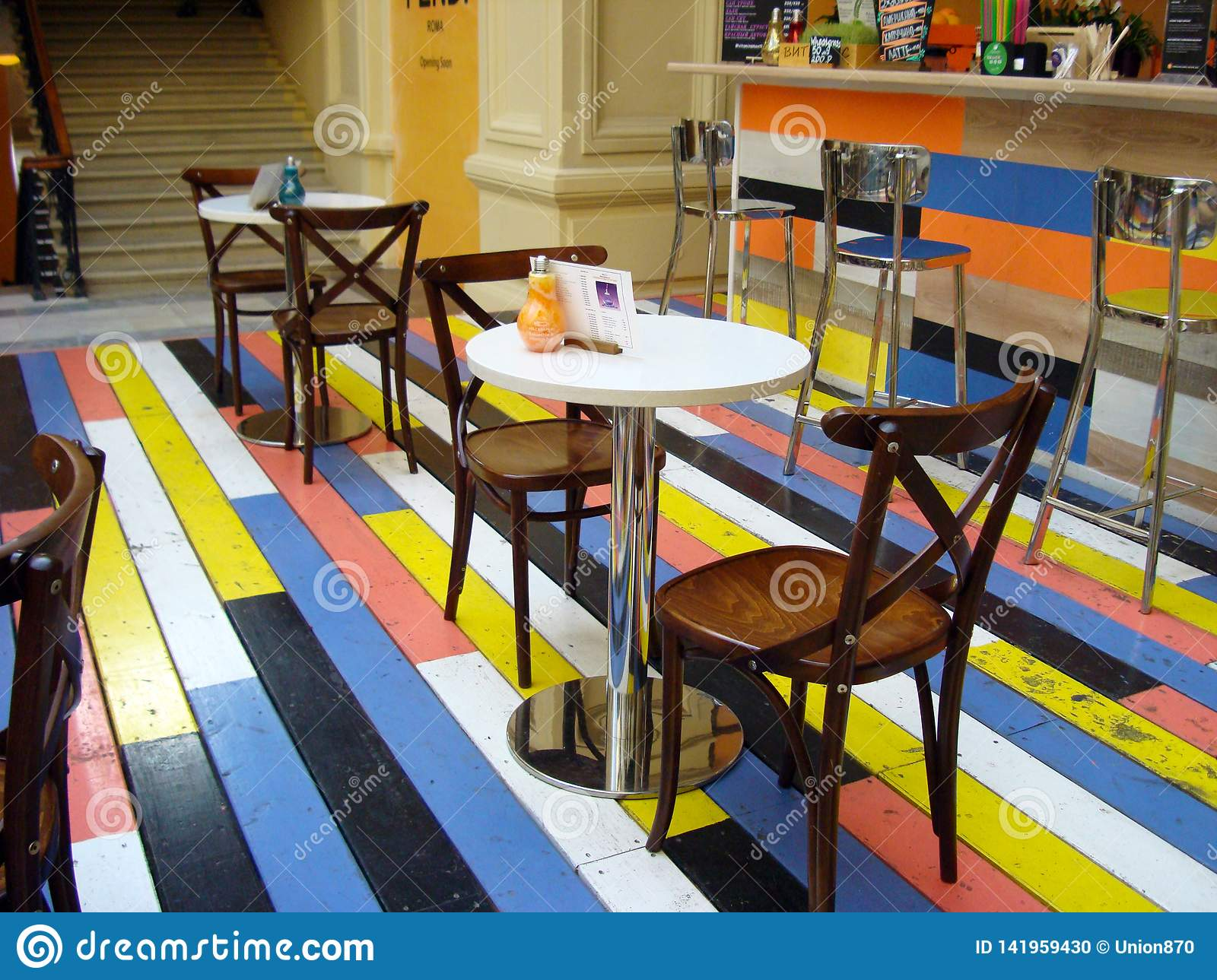 Cafe with colorful wooden floors in the shopping center