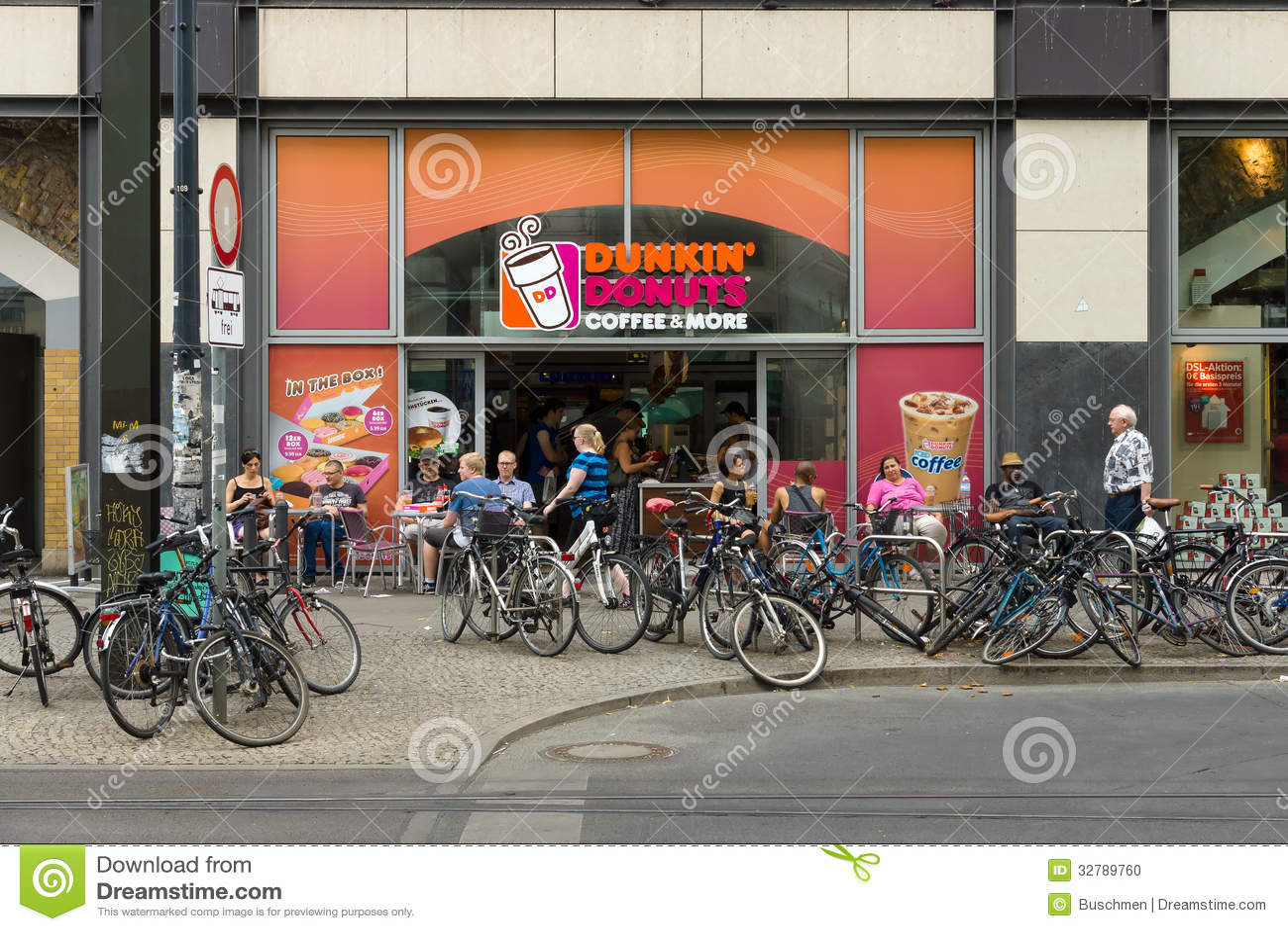 cafe dunkin donuts on alexanderplatz editorial image. Black Bedroom Furniture Sets. Home Design Ideas