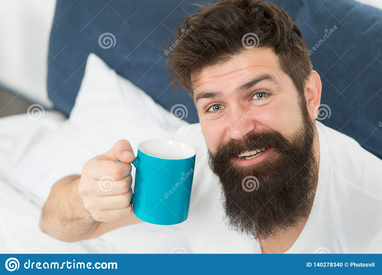 Caffeine addicted. Coffee fills you with energy. Good gay begins from cup of coffee. Coffee affects body. Man handsome