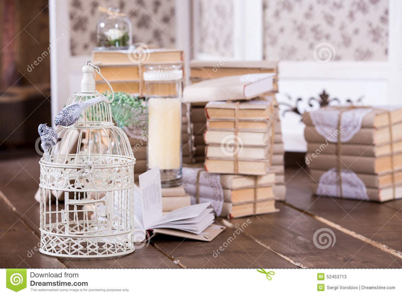 Cage with birds and old books heap in interior decoration stock photo image - Decoration cage oiseau ...
