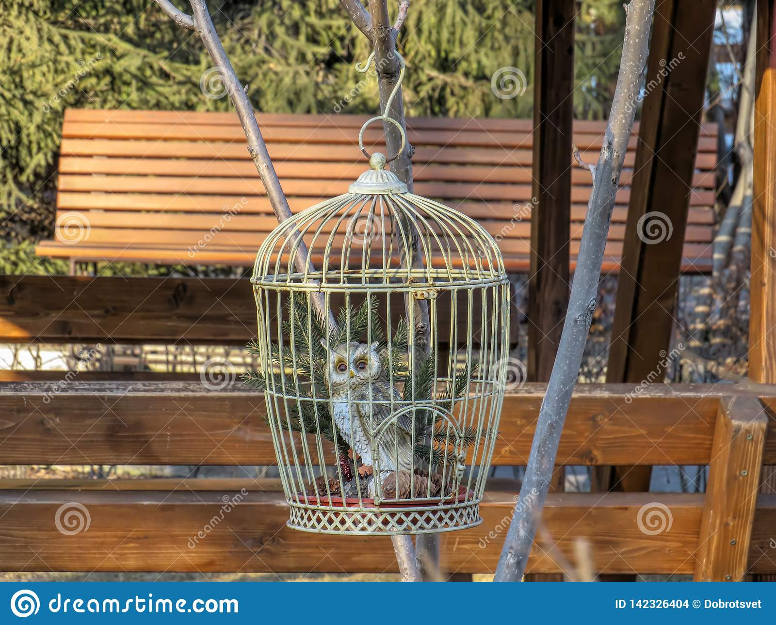Cage With Owl Figurine Hanging On A Branch In The Garden Stock Photo Image Of Totem Dummy 142326404