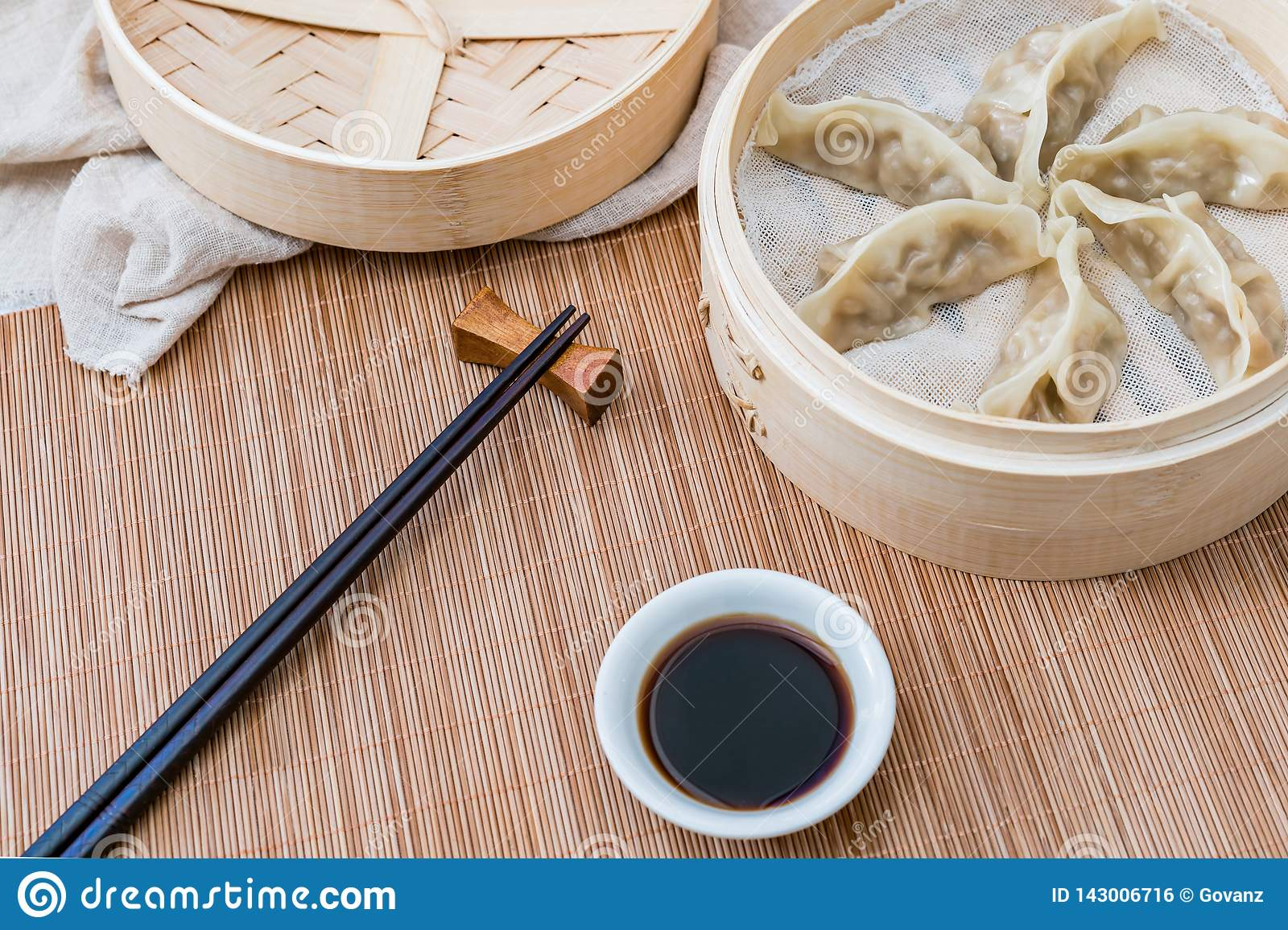 A cage of steamed dumplings, a traditional Chinese delicacy