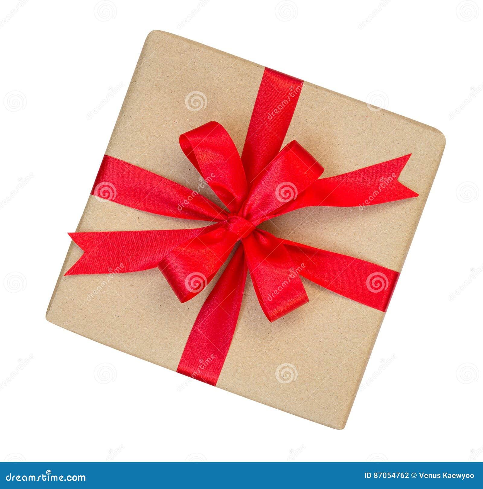 A caixa de presente envolvida no marrom reciclou o papel com parte superior vermelha da curva da fita