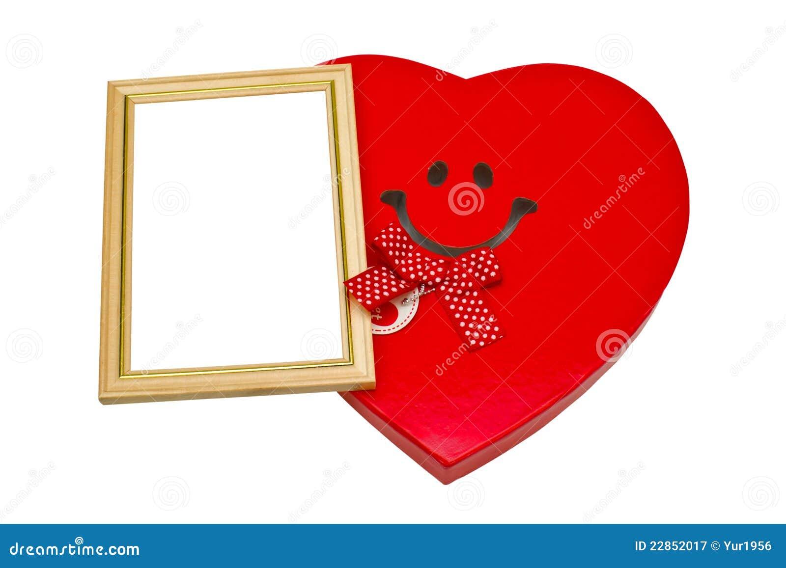 Caja Bajo La Forma De Corazón Y Un Marco Para Las Fotos Imagen de ...