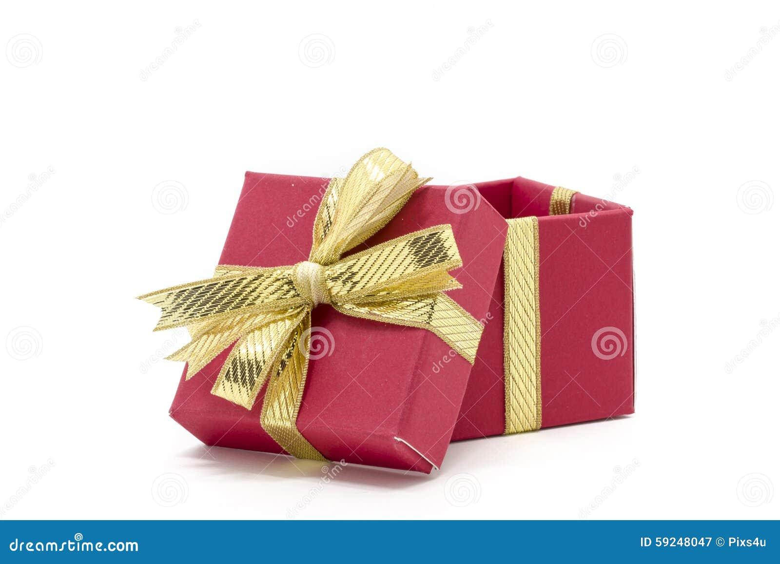Caja de regalo de la Navidad con un arco de la cinta del oro