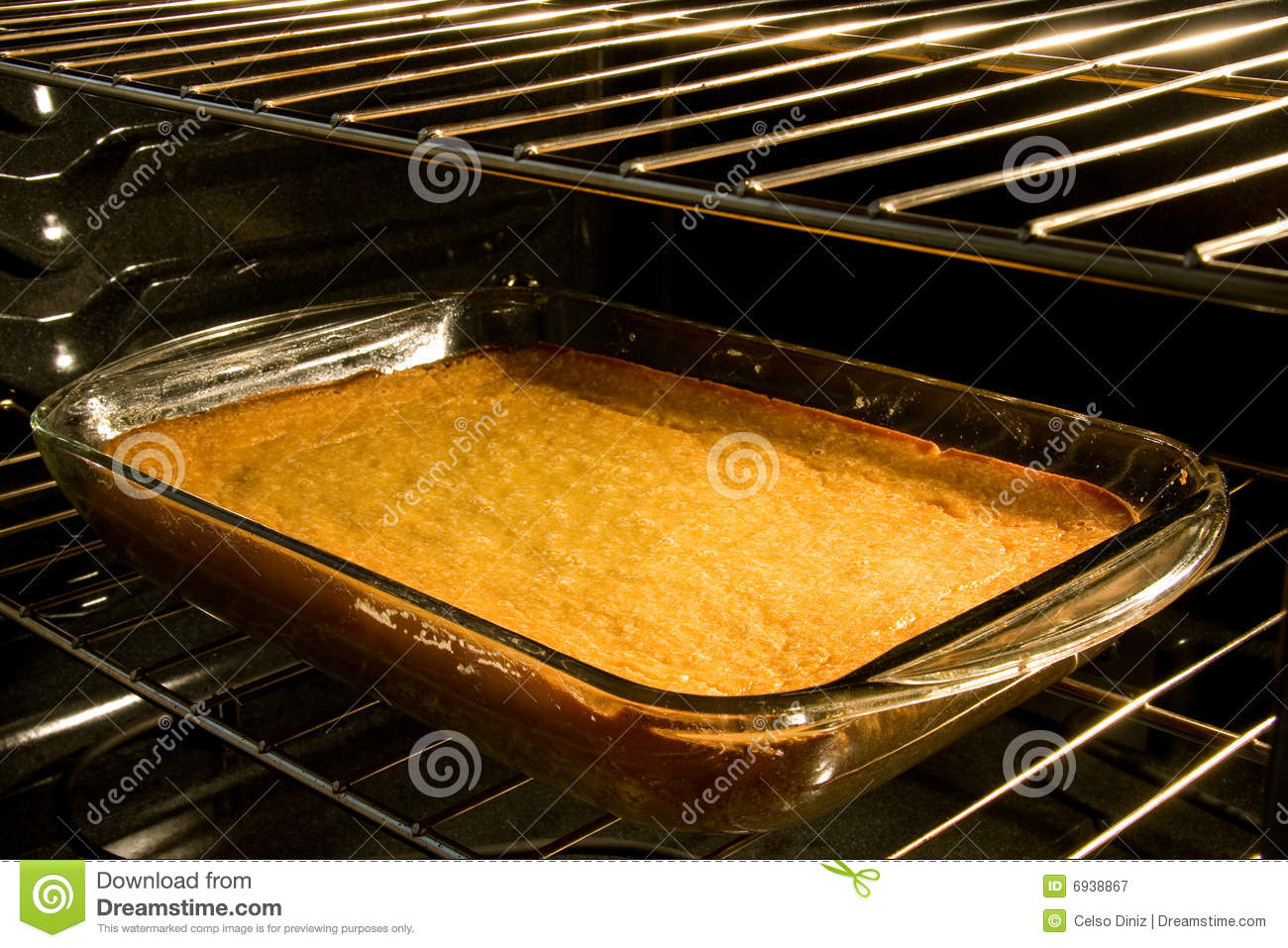 Cake In Oven ~ Corn cake baking in oven royalty free stock photography