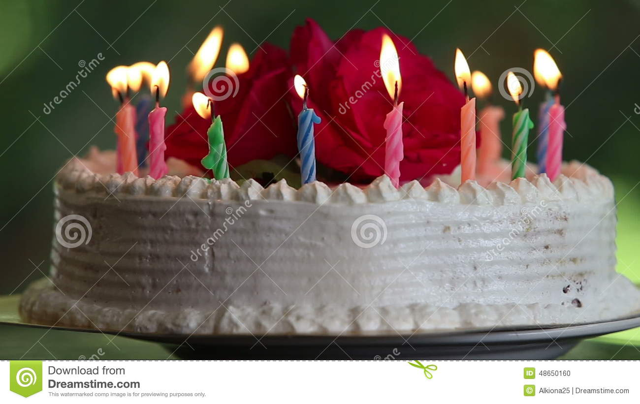Cake With Burning Candles And Flowers Stock Footage