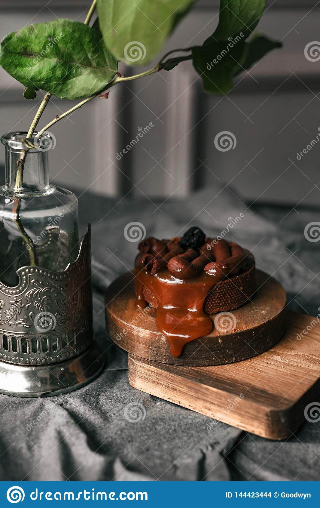 Cake with caramel and chocolate on a wooden stand