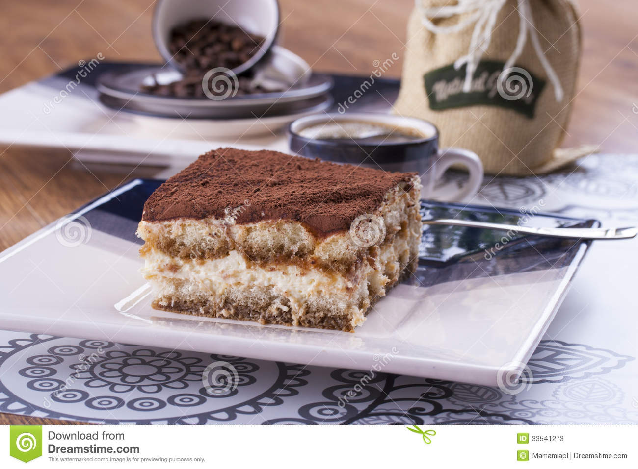Close up photo of the tiramisu - sweet dessert with biscuits wiped in ...