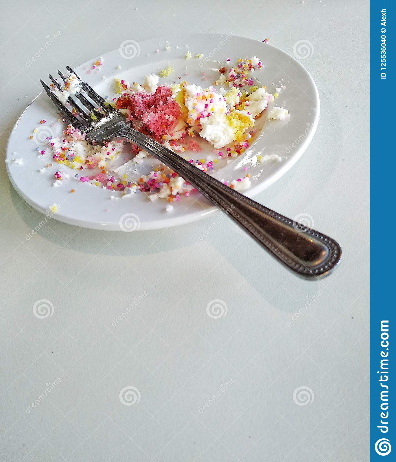 Stock Photo of Empty plate with crumbs and candle, elevated view x75077162 - Search Stock ... |Empty Plate With Crumbs Clipart