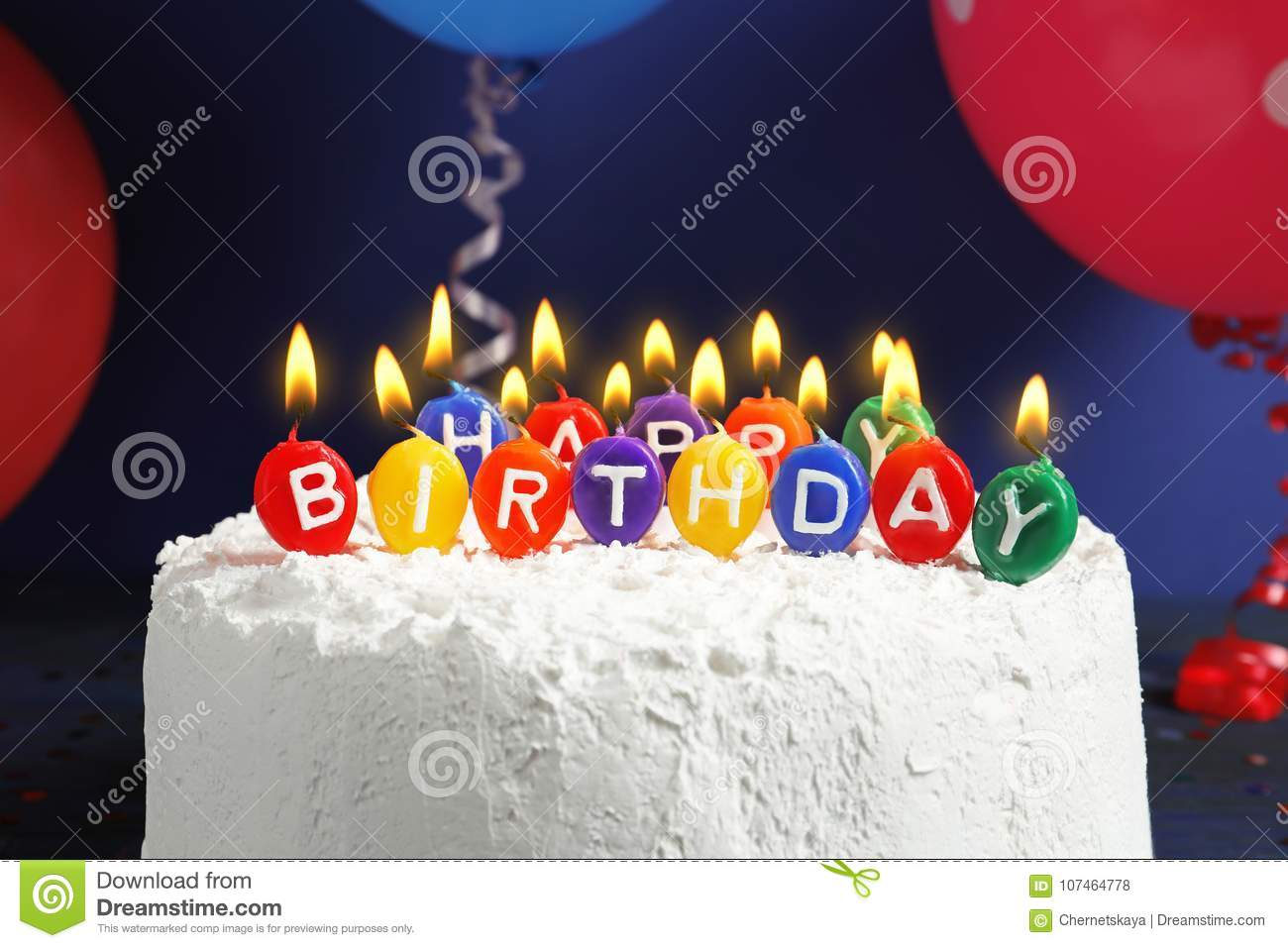 Cake With Happy Birthday Candles On Dark Background Stock Photo