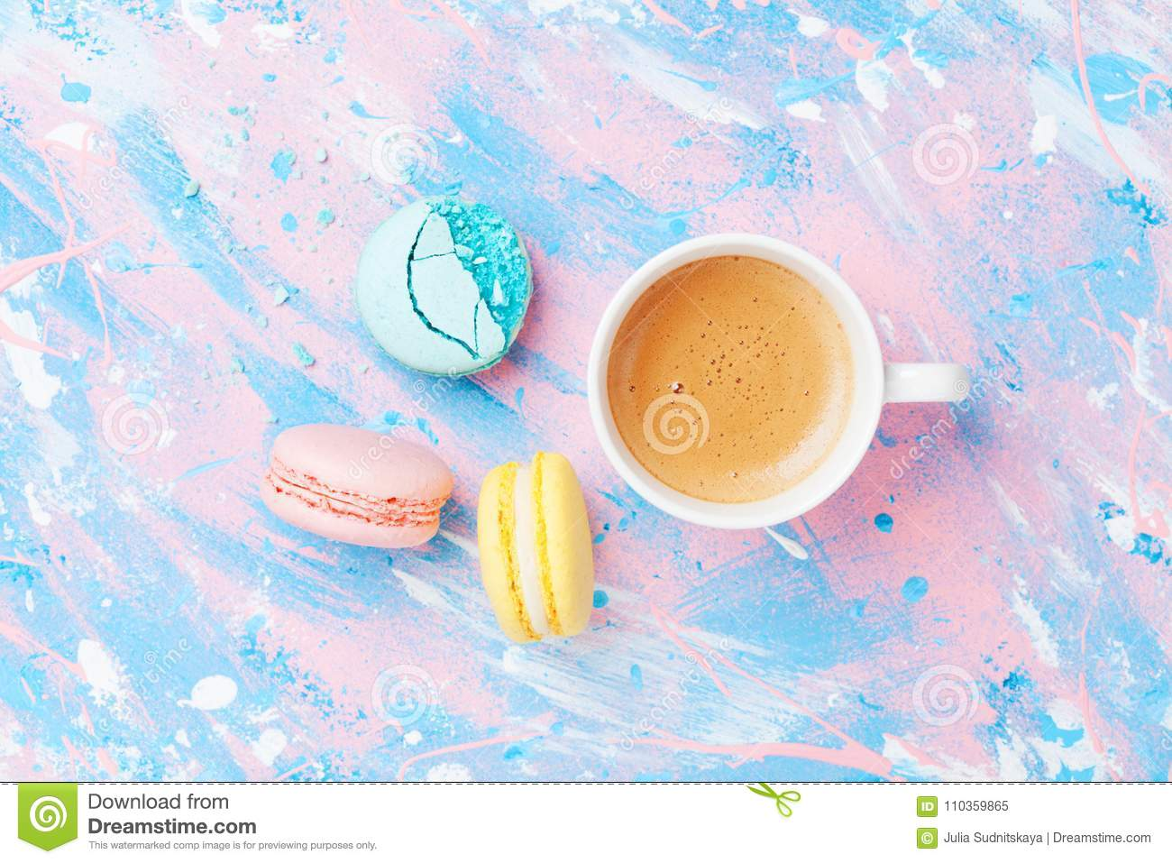 Cake macaron or macaroon and cup of coffee on colorful table top view. Flat lay. Creative breakfast for Woman day. Punchy pastel.