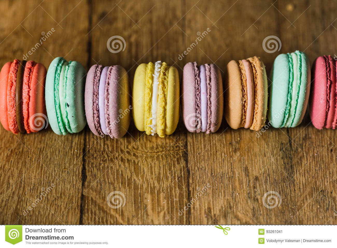 Cake macaron or macaroon on turquoise background from above, col